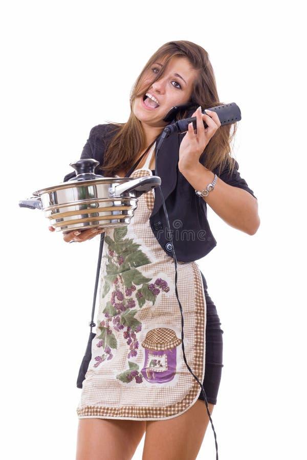 设法无经验的女性的厨师是主妇谈话在 免版税库存照片