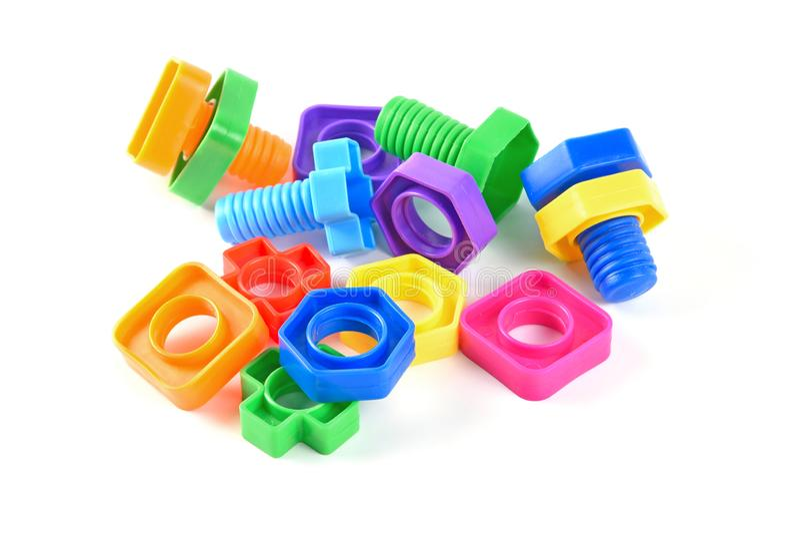 设置五颜六色的塑料螺丝和螺栓当儿童玩具 免版税库存照片