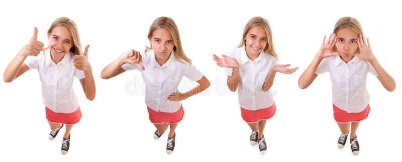 设置做一张滑稽的面孔的乐趣大角度充分的身体十几岁的女孩,使用用她的笑话的手,被隔绝 图库摄影