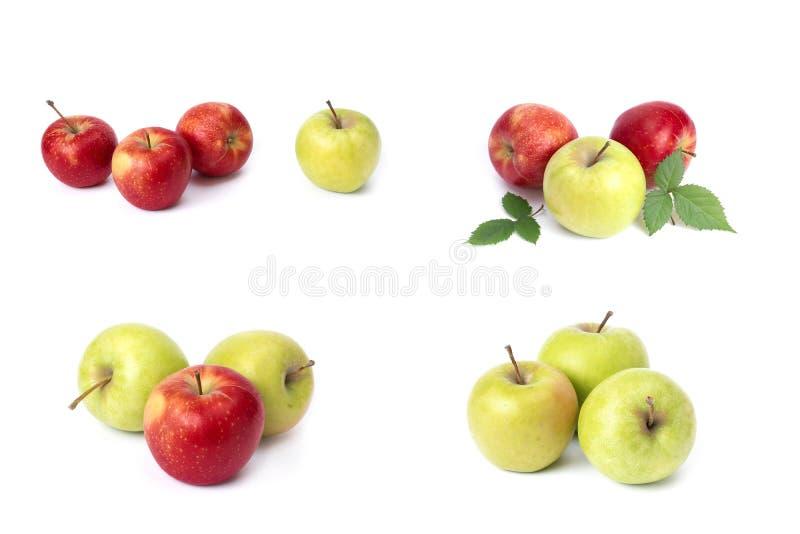 设置在白色背景的红色苹果 红色水多的苹果与黄色斑点的在白色背景 库存照片