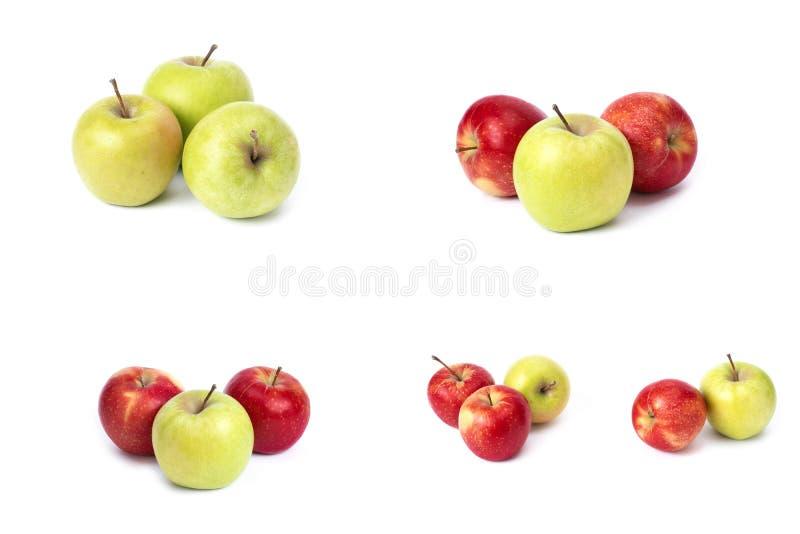 设置在白色背景的红色苹果 红色水多的苹果与黄色斑点的在白色背景 库存图片