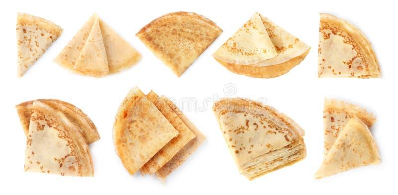 设置在白色,顶视图的被折叠的鲜美稀薄的薄煎饼 库存照片