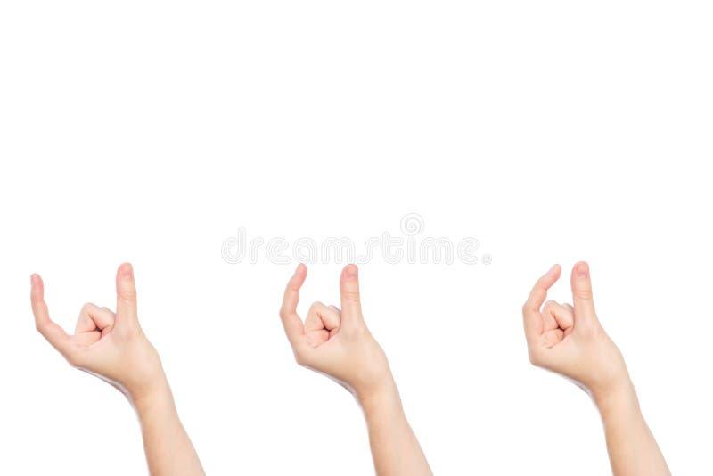 设置妇女手展示在白色隔绝的大小姿态 图库摄影