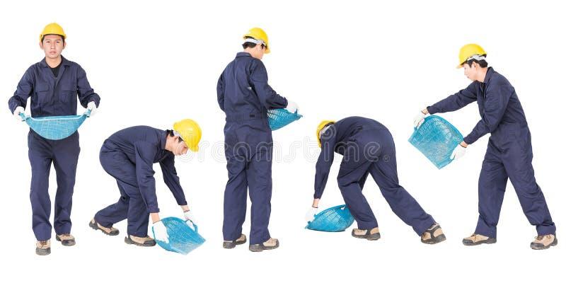设置年轻工人举行煤斗或蛤壳状机件形状的篮子 免版税库存照片