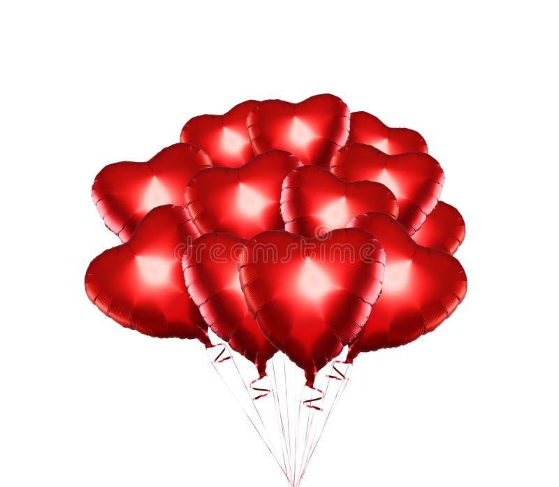 设置气球 束在白色背景隔绝的红色心形的箔气球 ? r 图库摄影