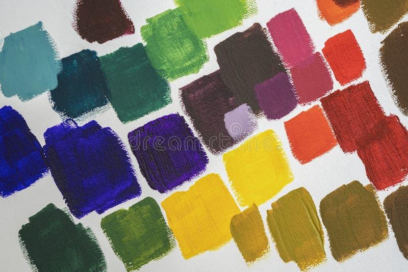 设置油漆不同的明亮的污迹在白色调色板,生活所有场合的抽象五颜六色的背景的  免版税库存照片