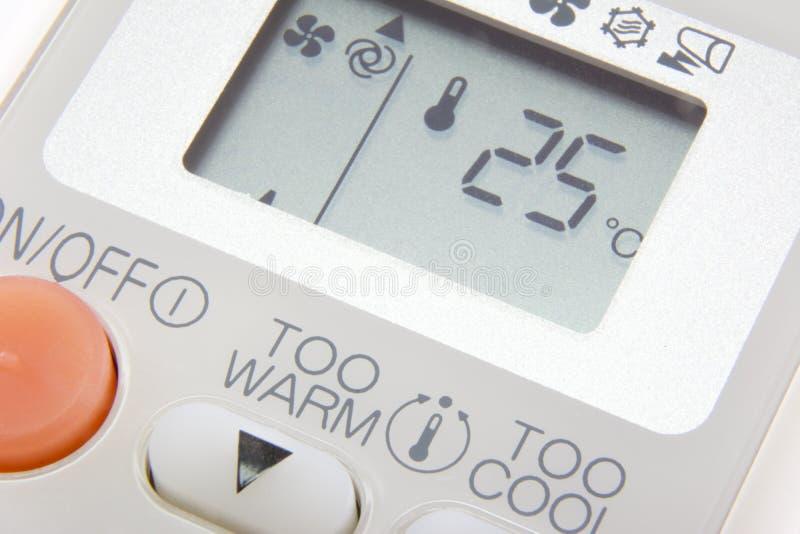 设置温度在遥控空气情况的25度 免版税库存照片