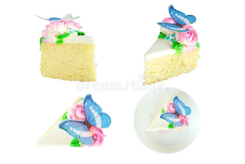 设置片断香草蛋糕用黄油奶油、桃红色玫瑰和蓝色蝴蝶装饰在盘被隔绝的和白色背景 免版税图库摄影