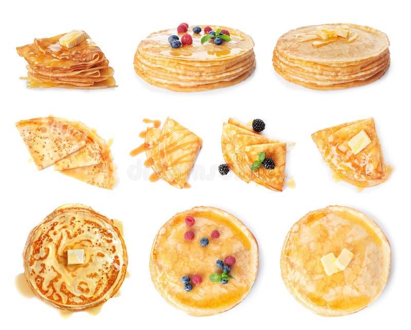 设置用不同的顶部的鲜美稀薄的薄煎饼在白色 图库摄影