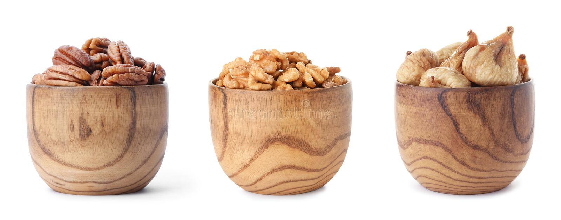 设置碗用健康干果子和鲜美坚果在白色 免版税库存图片