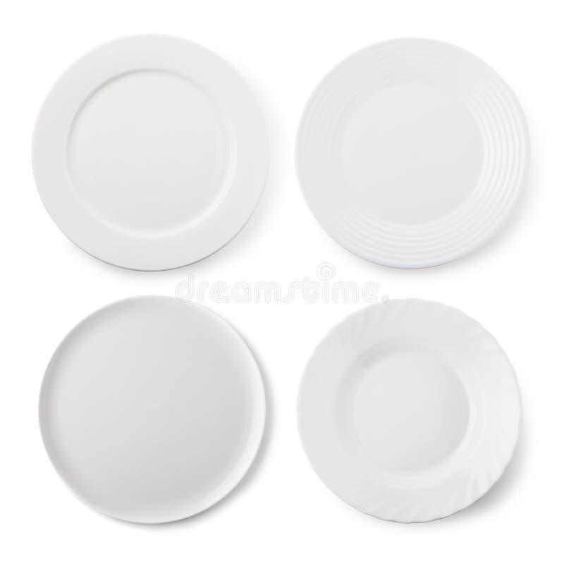 设置空的白色陶瓷板材,被隔绝的对象顶视图  免版税库存图片