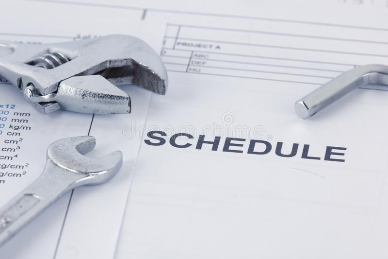 设计与板钳的日程表文件 Maintencance概念 库存图片