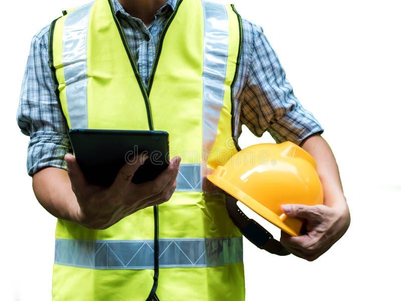 设计与黄色安全帽的人身分和拿着片剂被隔绝在白色背景,工作概念 免版税库存图片
