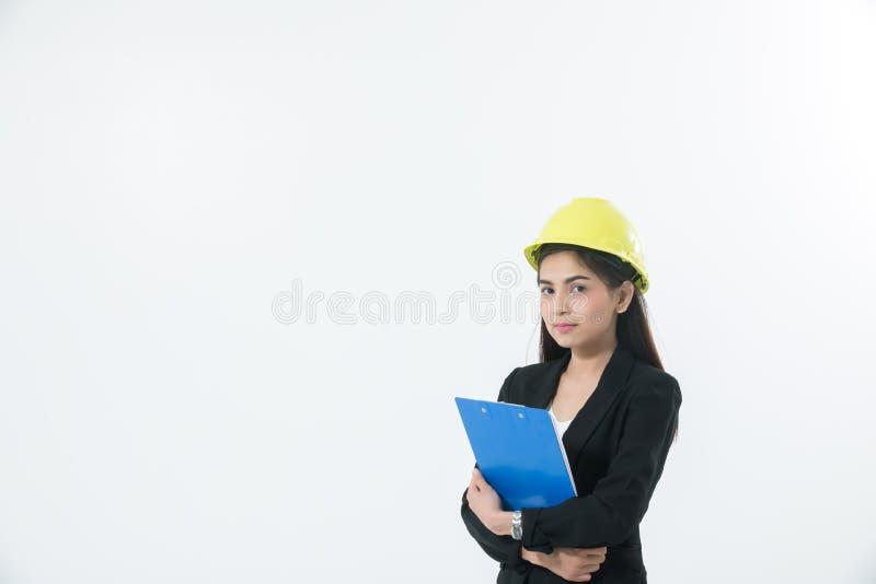 设计检查和工作和拿着蓝色的亚裔妇女 免版税库存照片