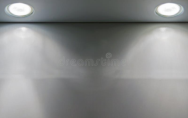 设计的两盏聚光灯背景或盖子 抽象背景灰色纹理 库存图片