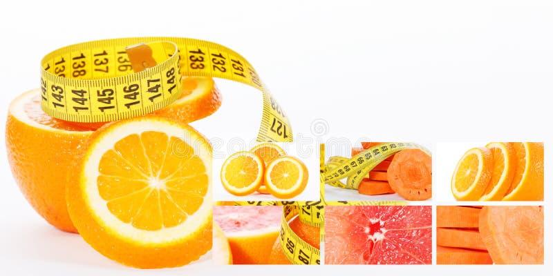 评定的橙色磁带 健康概念用红萝卜葡萄柚和切片桔子 库存图片