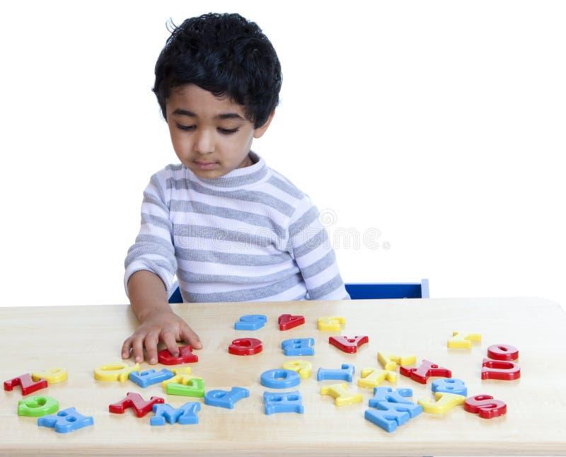 识别编号学龄前儿童的字母表 免版税库存图片