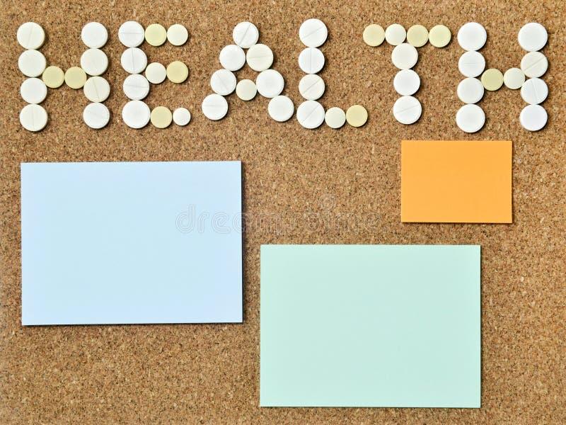 词健康写与药片和稠粘的笔记 免版税库存图片