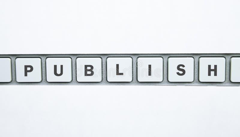 词在键盘按钮出版 纸空间 图库摄影