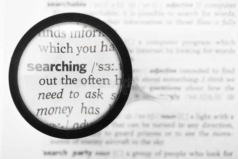 词搜寻的放大镜和辞典定义 库存图片