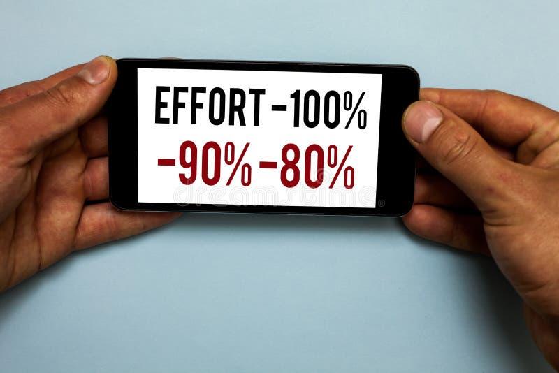 词文字文本努力100 90 80 决心学科刺激人的手举行智能手机w的水平的企业概念 库存照片