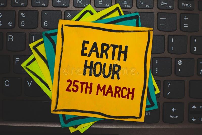词文字文本地球小时3月25日 标志承诺的企业概念对行星组织了全世界资金倍数colou 库存例证