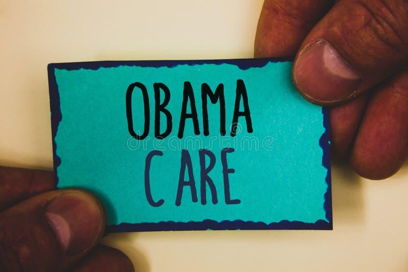 词文字文本奥巴马关心 保险系统患者举行turqu的ProtectionMan举行政府项目的企业概念  库存照片