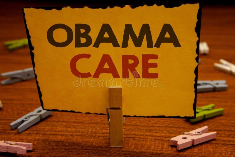 词文字文本奥巴马关心 保险系统患者ProtectionClothespin举行holdin政府项目的企业概念  免版税库存照片