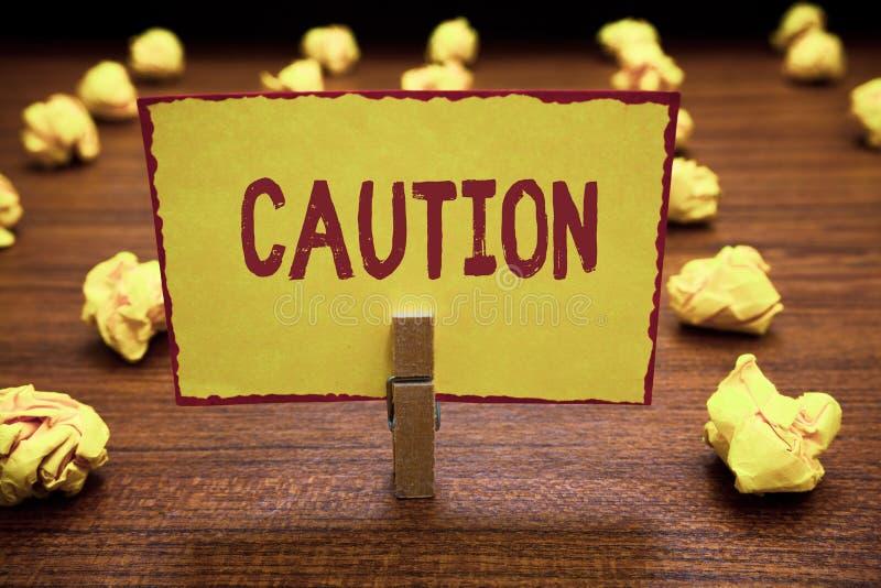 词文字文本小心 的企业概念保重避免危险或差错警报信号预防 图库摄影