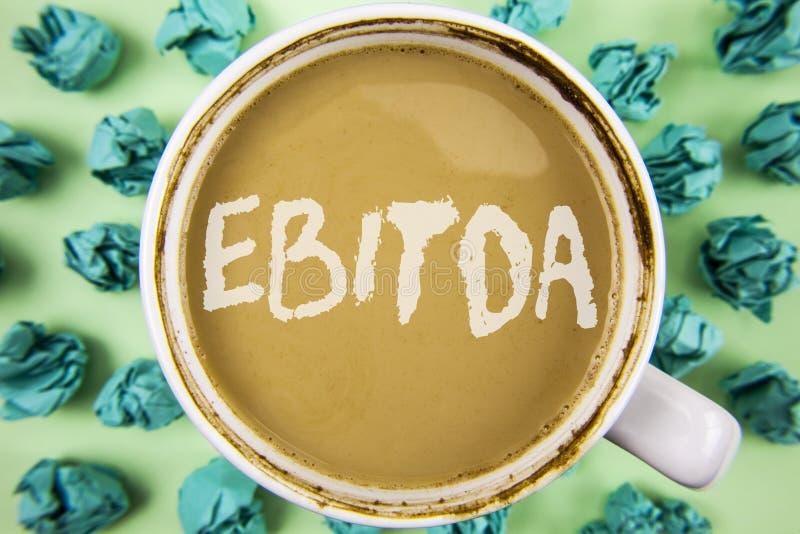 词文字文本Ebitda 收入的企业概念,在税被测量评估在茶写的公司表现在W前 库存图片