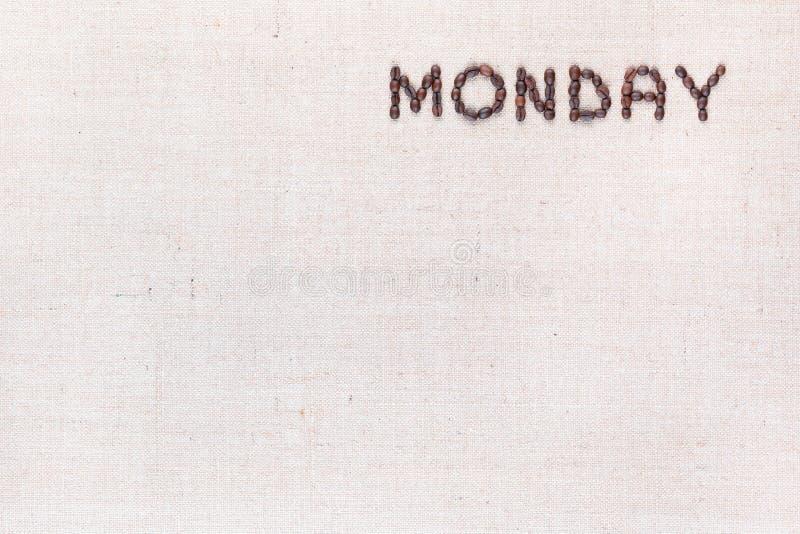 词星期一写与咖啡豆,被排列在右上 免版税库存照片