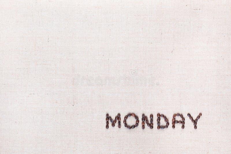 词星期一写与咖啡豆,被排列在右下 免版税图库摄影