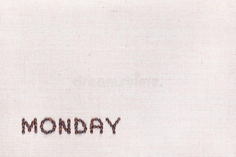 词星期一写与咖啡豆,被排列在左下 免版税库存照片
