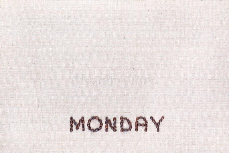 词星期一写与咖啡豆,被排列在底部 库存照片