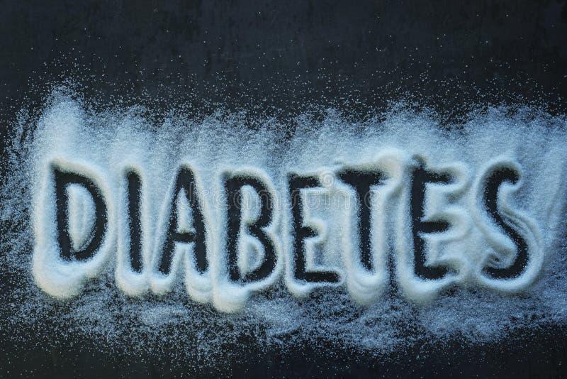 词糖尿病被写入堆白色砂糖 库存照片