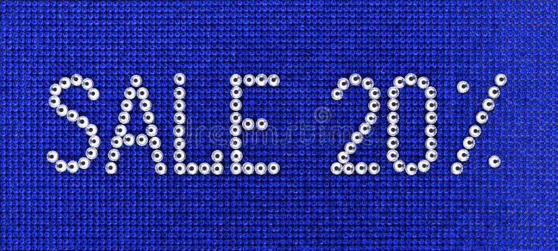 词销售在蓝色帆布bac被做假钻石水晶颜色 免版税库存图片