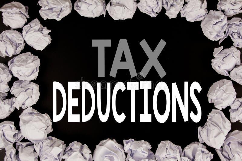词,写税收减免 在与拷贝spac的黑背景写的财务接踵而来的税钱扣除的企业概念 免版税库存图片