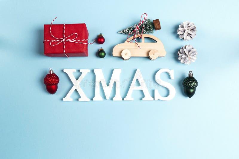 词XMAS和圣诞装饰与空间文本的在蓝色 免版税图库摄影
