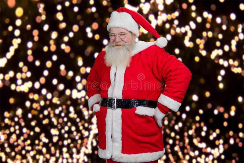 诗歌选背景的愉快的圣诞老人 库存照片