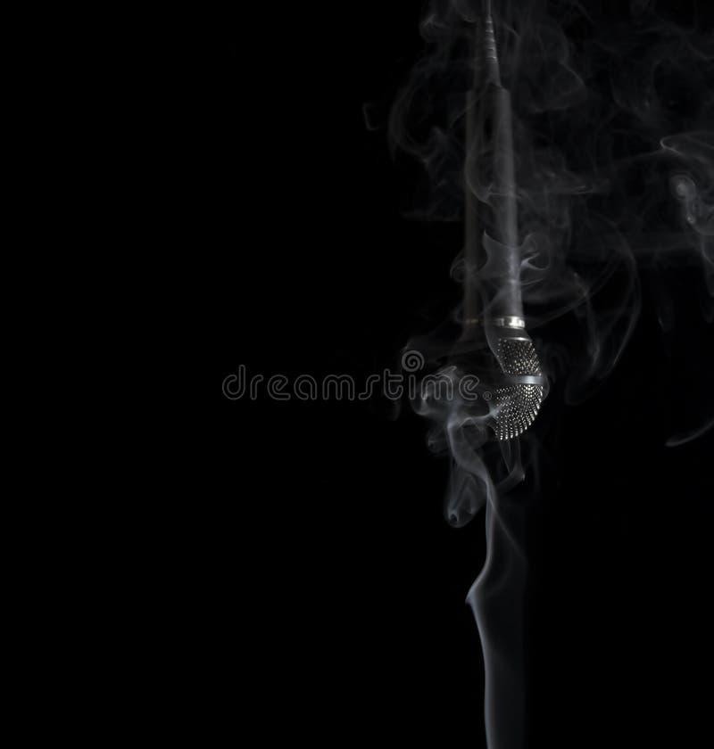 话筒抽烟 库存照片