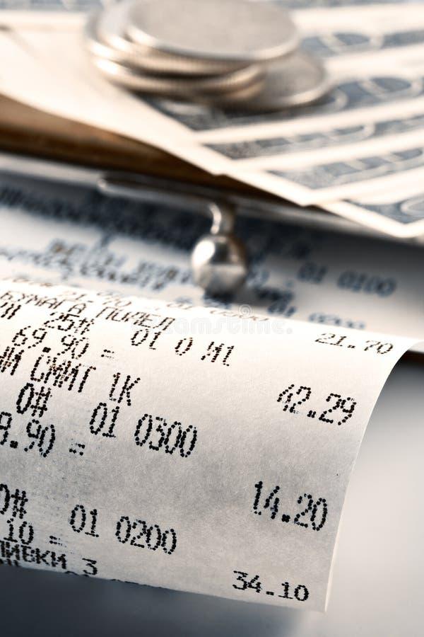 说明货币收货的现金花费 免版税库存图片