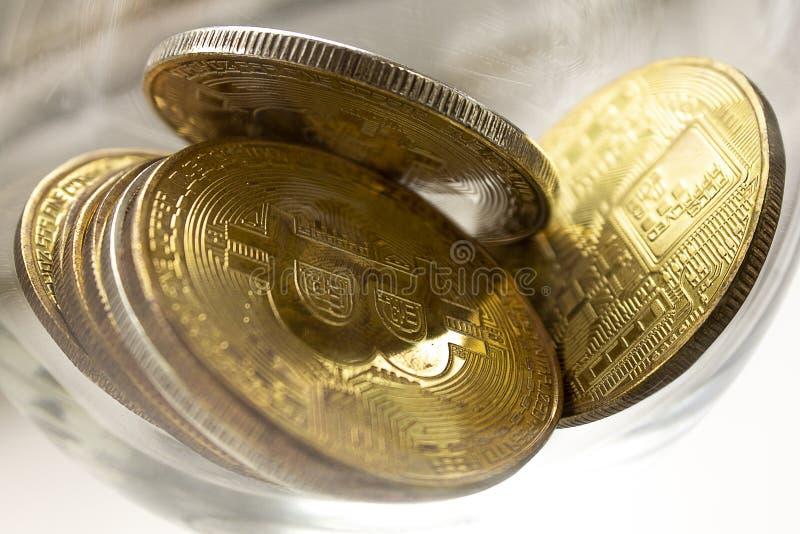 说谎在白色背景的金币bitcoins 图库摄影
