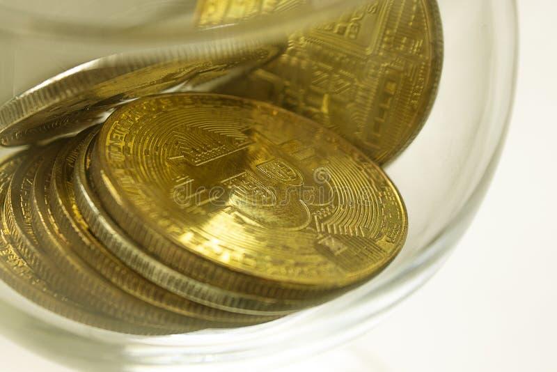 说谎在白色背景的金币bitcoins 库存图片