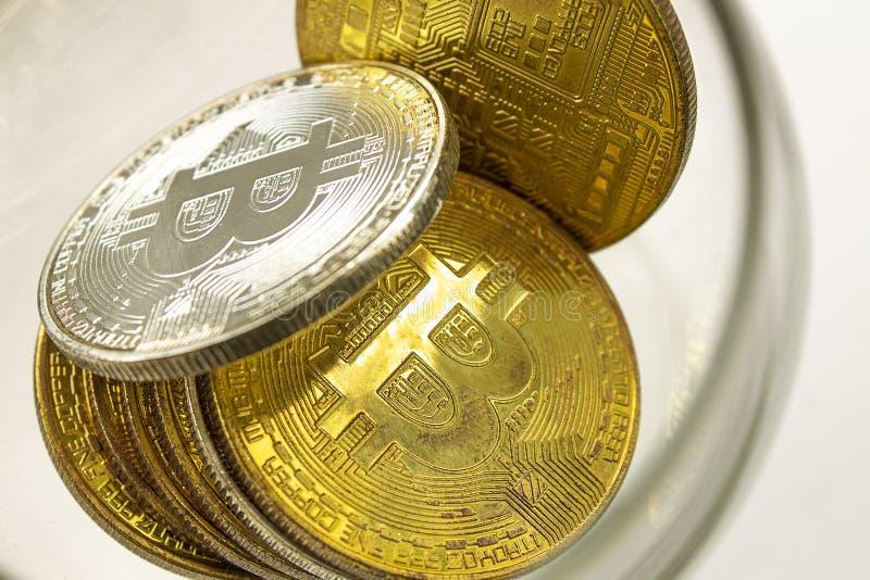说谎在白色背景的金币bitcoins 免版税库存照片