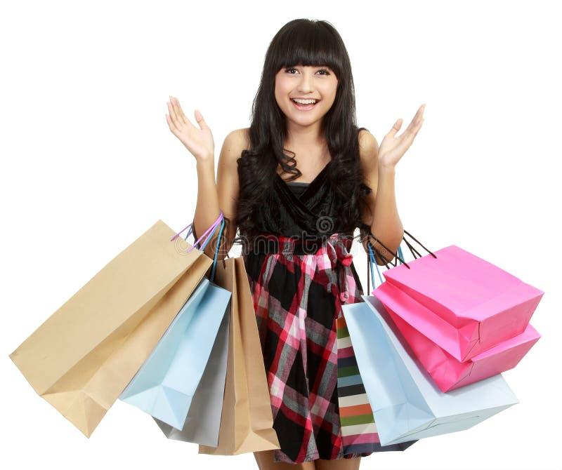 请求愉快的购物妇女 免版税库存照片