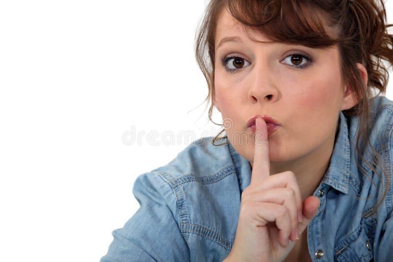请求的妇女沈默 免版税库存照片