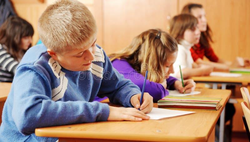 课程的男小学生 免版税库存照片