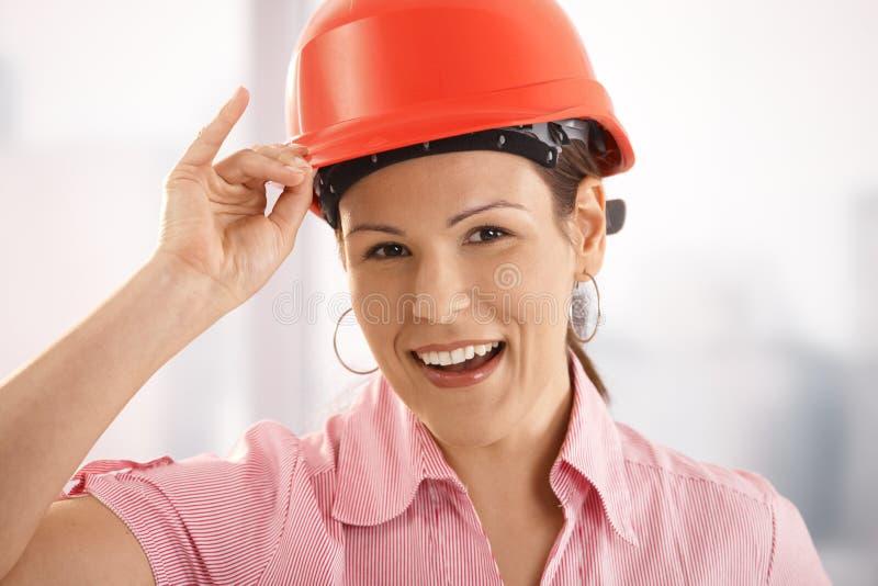 调整建筑师女性安全帽她 图库摄影