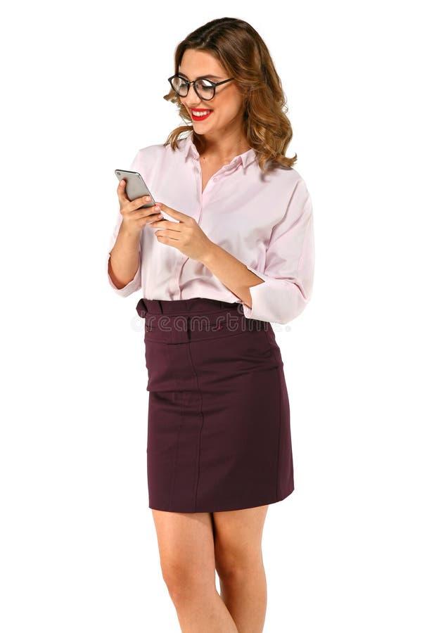 调查电话的美丽的女商人 库存图片