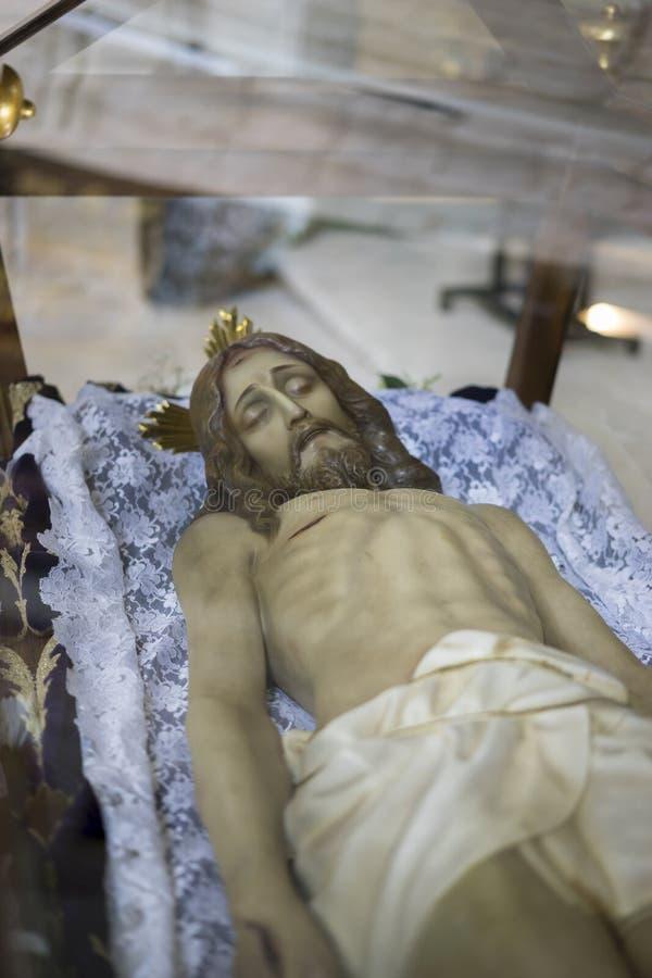 说谎的耶稣基督贞女和稀土的圣周在西班牙,图象 库存图片